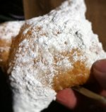 Beignets (NOLA's version of the beavertail) Warning! You will be covered in powdered sugar after trying these.